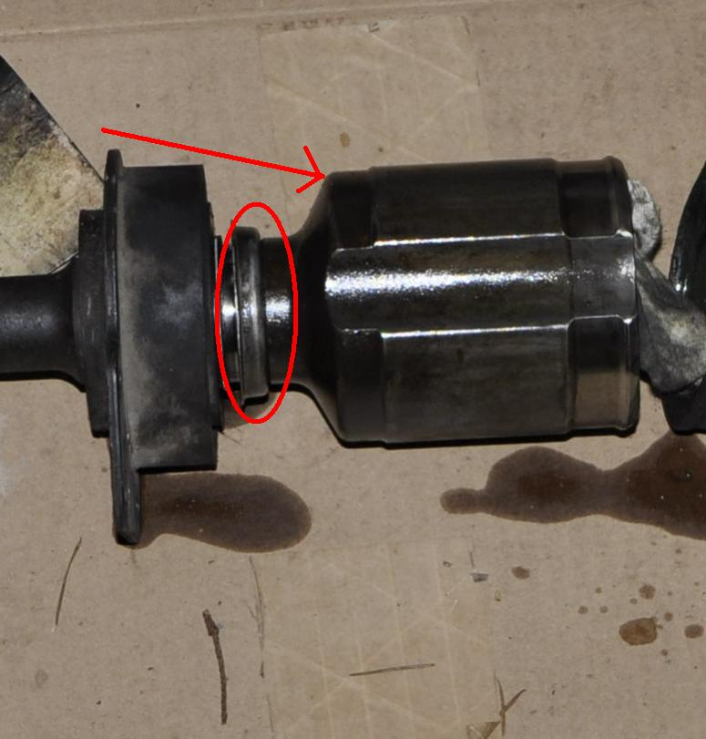 Removing Passenger CV halfshaft from Intermediate Shaft-axle.jpg